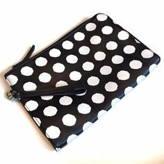 Black and White Polka Dot Wristlet Clutch I only used this once or twice. It's really cute but I have way too many small bags. Inside there is a zip pocket and two slip pockets. Will fit an iPad mini (not sure about a regular iPad but measurements are listed). Sorry, no trades. Merona Bags Clutches & Wristlets