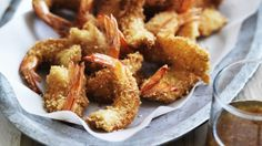 You can use ordinary breadcrumbs for the prawns, but the panko variety have a really great crunch. A little finely sliced pickled ginger is also great through the honey soy sauce.