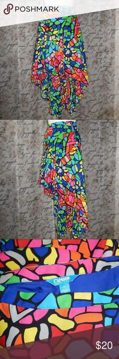 Nanette Lepore Multi Hi Lo Skirt Sz M Nanette Lepore Multi Hi Lo Skirt Sz M Versatile and chic, this vibrant midi skirt with a high/low hem is the perfect look for impromptu dinner dates.  100% Polyester. Waist to hem 18-32.  Waist 27. Nanette Lepore Skirts High Low