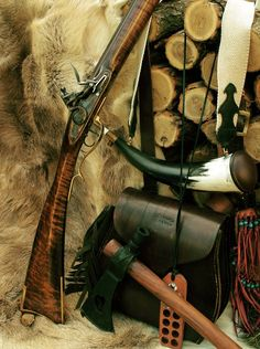 Shooting accoutrements of Black Powder Rifle.  Powder horn, Shooting bag and bullet board, Tomahawk