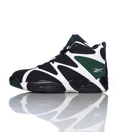 2a5033a2ff0f33 REEBOK Men s mid top sneaker Lace up closure Padded tongue with logo  Cushioned inner sole for