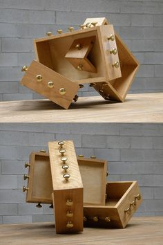 Me(knobs) a Trois, by artist Victoria Fuller, wooden drawers and recycled doorknobs - http://victoriafullerartist.com/