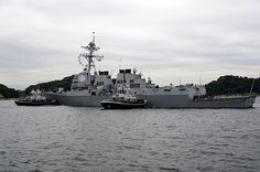 The Valiant-class yard tugboats USS Menominee (YT-807) and USS Seminole (YT 805) assist the Arleigh-Burke class guided-missile destroyer USS McCampbell (DDG 85) in mooring at Fleet Activities Yokosuka (FLEACT) following its patrol of the U.S. 7th Fleet area of responsibility.