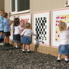 Outdoor wall games: imagine these inside too, on room dividers, or in large shared/community spaces in the building...