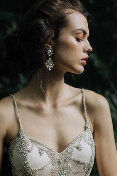 Crystal beaded bodice wedding dress + crystal chandelier earrings | Image by Paula O'Hara