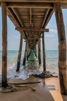 Under the pier on Sunset Beach located on the paradise island of Koh Rong Samloem in Cambodia.