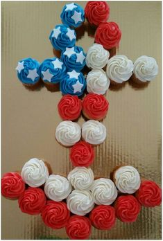 """Almost a pull-apart anchor cake, instead of decorating across it, I put a classic cupcake swirl on them on the top, and """"painted"""" corn syrup on the bottom of each cupcake to hold them into place. I used a full sheet cake board & box. There are 30 cupcakes shown here."""