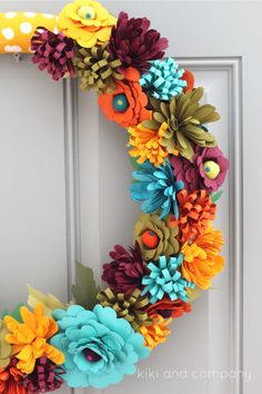 DIY Fall Flower Wreath- free patterns to make these paper flowers and turn them into a darling fall wreath for your door! How CUTE is this?!