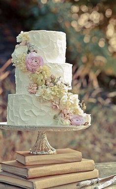 Love the flowers and the mercury glass cake stand.