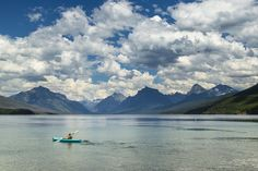 #activity #boat #calm #clouds #fun #glacier national park #kayaker #kayaking #lake mcdonald #landscape #leisure #montana #mountains #oars #paddle #peaceful #peak #recreation #reflection #skyline #tranquil #usa #water