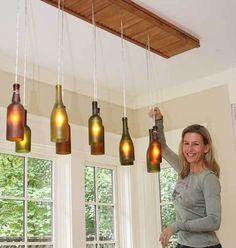 Lights made from recycled wine bottles! Reuse Bottles, Recycled Wine Bottles, Lighted Wine Bottles, Bottle Lights, Beer Bottles, Empty Bottles, Garage Lighting, Kitchen Lighting, Bottle Art