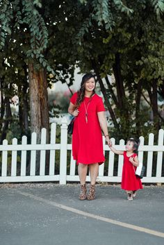 Mommy and me style in matching red dresses