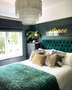 This dramatic deep green bedroom is giving us tropical vibes. We've noticed a trend towards dark, moody bedrooms, and if you've been contemplating trying this trend for your own, here are 16 ideas you should check out.