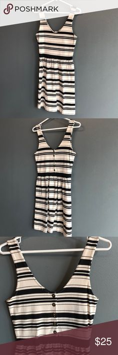 """J. Crew Villa Dress in Stripe J. Crew Villa Dress. Size small. Color off white and black stripes. Cute button detail on back of dress. Fitted at waist with flirty skirt. Cotton knit. Hits a couple of inches above knee on me (I'm 5' 7""""). Great condition and super comfortable! J. Crew Dresses Mini"""