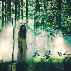 Green faerie in the emerald forest | misty enchanted woods | green | horns