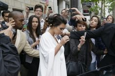 Kim Kardashian and Kanye West depart for a tour round Palace of Versailles