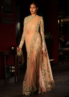 Model walking the ramp wearing sabasachi's peach net saree at Indian couture week July 2014
