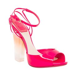 Add a pop of pink to any ensemble with these playful Christian Dior sandals. In a vibrant hot pink, these sandals are made from shiny patent leather with a fun PVC block heel.