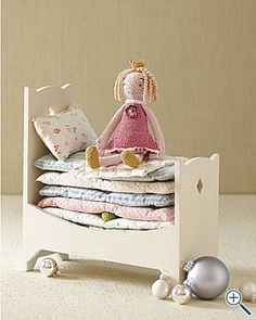The princess and the pea.  Love the little quilts/mattresses.