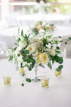 Silver compote vase filled with cream hydrangeas, ivory roses, ivory…