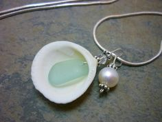Inspiration idea - shell with sea glass hanging from center w/pearl as accent.