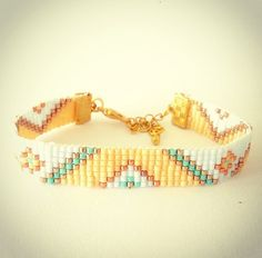 Tribal bead loom bracelet - friendship bracelet  Stylish, made of Miyuki beads in shades of baby blue, yellow, gold and aqua shades with an