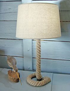 Handcrafted nautical rope table lamp with fabric shade. Stands 25 inches tall to top of shade.