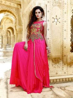Charming pink color net gown embellished with golden zari, cutdana work. Item code:  GWN808 Shop more:  https://www.bharatplaza.com/women/gowns.html