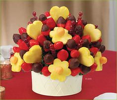 Edible Arrangements. I love how amazingly delicious chocolate covered fruit is....and when it's presented like this, that's super nice!