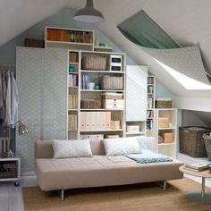 Attic living room storage, as featured in Ideal Home, photograph by Simon Whitmore.