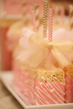 Sweet Simplicity Bakery: Wedding Dessert & Candy Display Buffet Table in Pink, Ivory & Gold; White Chocolate dipped Rice Krispies Treats on paper straws with tulle bows