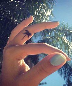 Wonderful Tiny  Tattoos On Finger