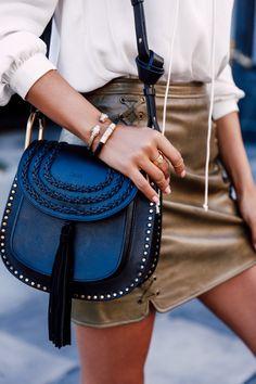 White blouse, olive mini skirt, gold bangles, and the Chloé Marcie bag in black.