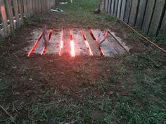 1 Pallet, 1 red light, some light digging, and a couple hands + awesomeness.. IN THE UGLY FLOWER BEDS IN THE FRONT