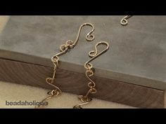 http://www.beadaholique.com/yt - In this tutorial, see how to make chain links, how to connect them, and how to make a clasp from wire. This is a great way of making a perfectly matched chain for a wrapped wire project.     Designer: Julie Bean    Ambrosia Earrings  Project E684  http://www.beadaholique.com/t-ba-project-E684.aspx?utm_source=YouTube.