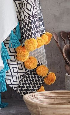 Decorate your towels with cute pom-poms, made with Novita Cotton Soft #novitaknits #pompoms #diy