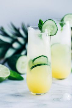 mint drink Pineapple Cucumber Lime Spritzers- pineapple juice served with cucumber, lime, and mint infused sparkling water makes for a light and refreshing drink thats perfect for summer!