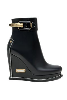 jil sander. and that little diddy on the wedge is to strap your stirrups into! love.