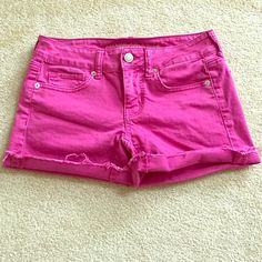 "AE Pink Denim Shorts Length: 11"". Style is meant to have the fringes and cuffed legs. Silver buttons/studs. In great condition. Worn once or twice. Stretch. Jean like material. American Eagle Outfitters Shorts Jean Shorts"