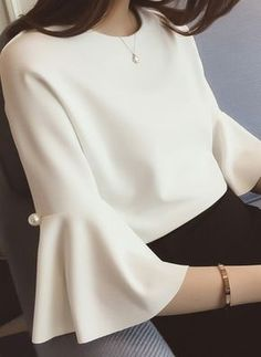 I love this flare sleeved blouse with pearl details - it's so fashionable whilst still being very office appropriate. Definitely my kind of corporate dress! Blouse Styles, Blouse Designs, Trend Fashion, Fashion Design, Fashion News, Women's Fashion, Casual Mode, Sleeves Designs For Dresses, Outfit Trends
