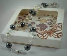 Necklace with hematite beads, glass crystals and silver accents by ButterflyJade on Etsy https://www.etsy.com/listing/223736686/necklace-with-hematite-beads-glass