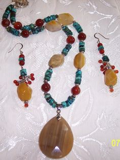 Botswana Agate,Grade A Turquoise, and gorgeous Red Carnelian Necklace and earring set. $98.00