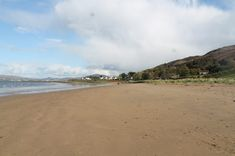 Lisfannon Beach is a long sandy beach with excellent views over Lough Swilly, Inch Island, and Rathmullan. It is on the outskirts of the village of Fahan with t Clean Beach, Photo Maps, Us Beaches, Get Directions, Summer Months, Island, Activities, Park, Water