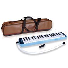 "Melodica - 37 Angel Note with Case - Angel Melodyhorn 37 note blow keyboards are ideal instruments for school use, solo playing or ensemble work. They are an inexpensive way to teach children the basics of keyboard playing and being non-electrical can be used in any environment. Robustly manufactured, the instruments can be played in ""recorder"" style or on a desk/table top."
