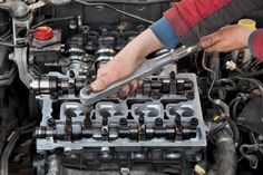 Mechanic fixing cylinder head with two camshaft of car engine with socket wrench. Expensive Sports Cars, Cars Series, New Sports Cars, Jaguar Xk, Car Engine, Car In The World, Car Detailing, Car Ins, Car Parts