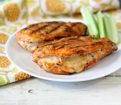 Grilled Cheesy Buffalo Chicken (Can grill or bake at 375 for 35 min.  Also could do stovetop or Forman grill. 1 lb. chicken breasts, 1/4c. shredder mozzarella. Many good comments on site.)
