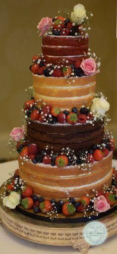 All flavours here: vanilla sponge, chocolate and red velvet with fresh flowers. #weddingcake #nakedcake #freshfruitcake #Hertfordshire