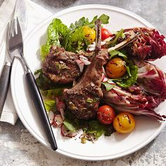 Warm Salad with Lamb Chops: This savory grilled salad features wedges of radicchio, cherry tomatoes and lamb chops.