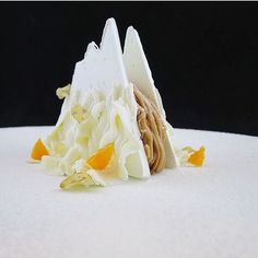 "Inspired by The Mont-Blanc, a century dessert, with coconut meringue covering a tiered slice of ""dacquoise"", mandarin gelée, and chestnut-cognac vermicelli by Gourmet Desserts, Plated Desserts, Dessert Recipes, Food Design, Dessert Original, Decoration Patisserie, Dacquoise, Michelin Star, Beautiful Desserts"