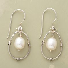 """PENDULUM PEARL EARRINGS--Our hand-wrought sterling silver earrings with winsome white pearls swoon and sway to mesmerizing effect. Exclusive. 1-3/8""""L."""
